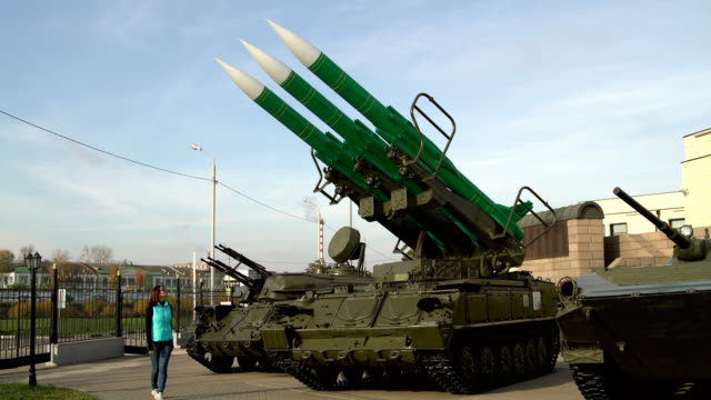Girl takes foto on the smartphone self-propelled launch system of the anti-aircraft missile system A woman takes pictures on the smartphone self-propelled launch system of the anti-aircraft missile system nuclear missile stock videos & royalty-free footage
