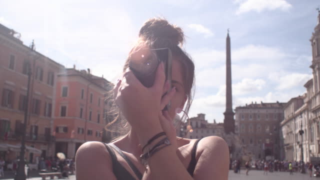 Girl takes pictures in the city