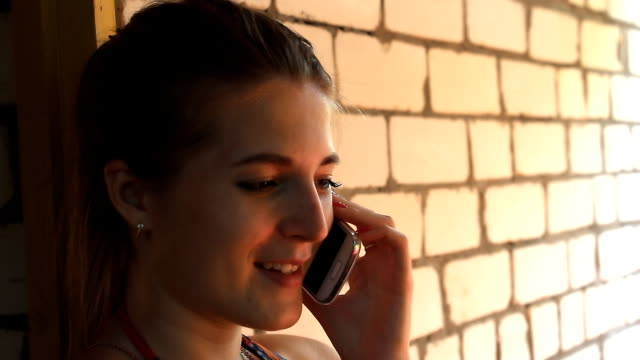 Girl talking on the phone and smiling video