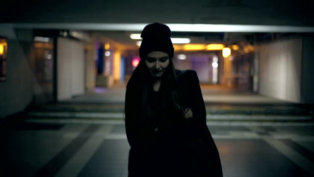 Girl teenager goes at night in the underpass video
