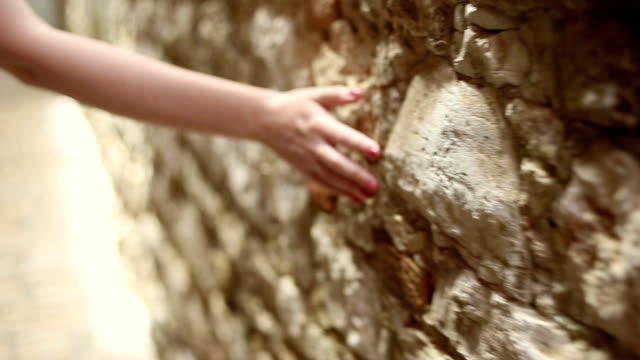 Girl touching old stone wall video