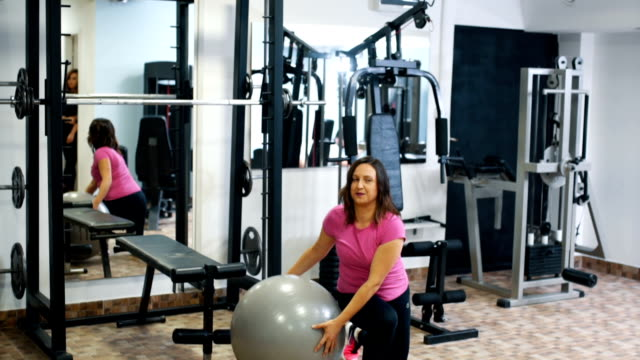Girl training with fitness ball video