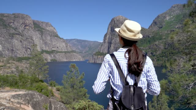 girl traveler using smart phone taking picture