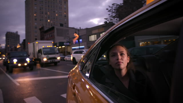 Girl traveling through New York in a cab video