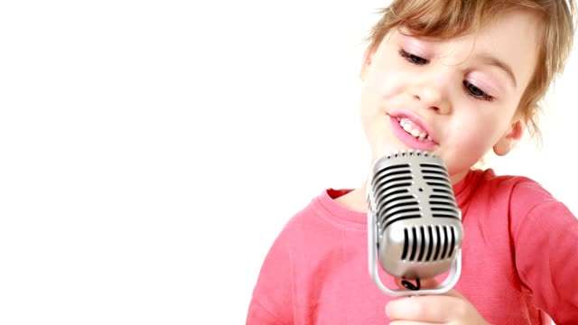 Girl twitches and sings in microphone video