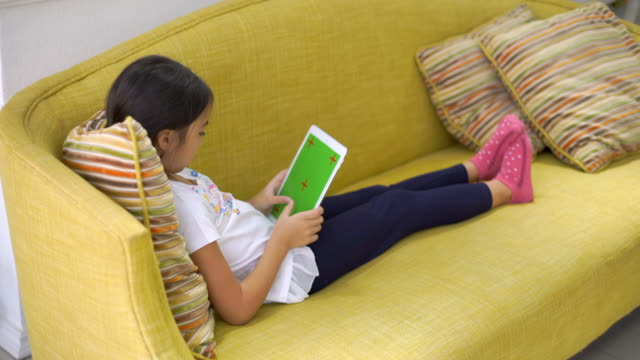 Girl Use Digital Tablet On Sofa video