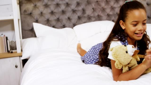 girl using digital tablet in bedroom 4k - rappresentazione umana video stock e b–roll