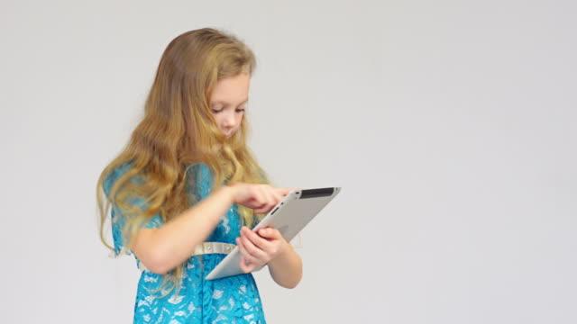 Girl using digital tablet video