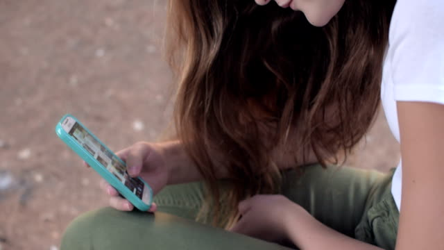 Girl using smart phone video