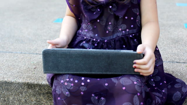 girl using tablet PC girl using tablet PC pinching stock videos & royalty-free footage