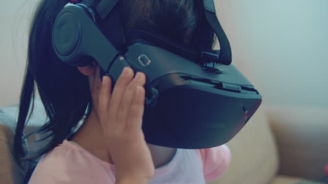 Girl Using VR Headset Virtual Reality Simulator