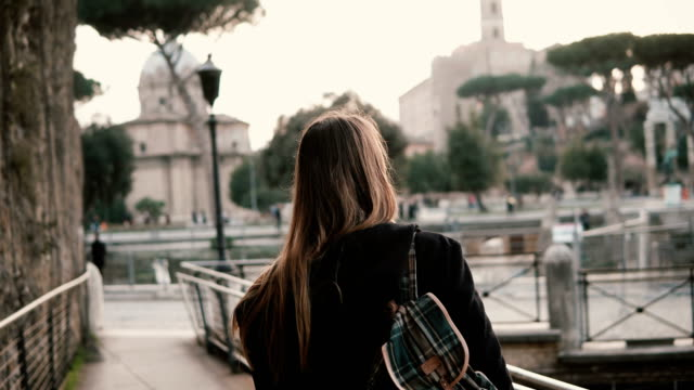 Girl walking around Rome, Italy, seeing over antique and beautiful city. Woman exploring ancient ruins of Roman Forum video
