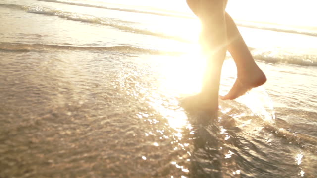 Girl walking in water video