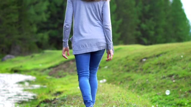 girl walking near the forest