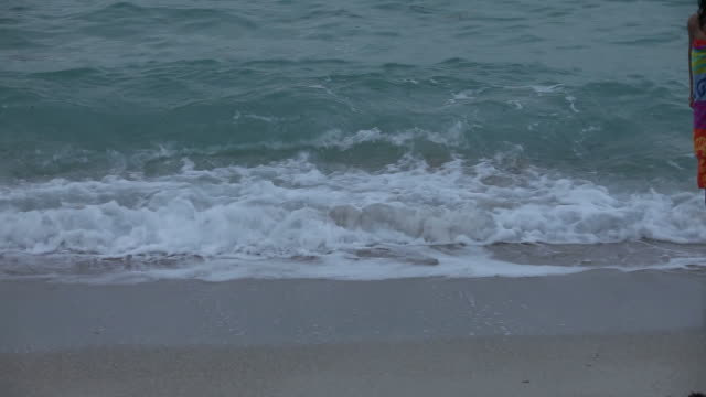 Girl Walking on a Beach Girl Walking Across Slowly on a Beach wearing a towel stock videos & royalty-free footage