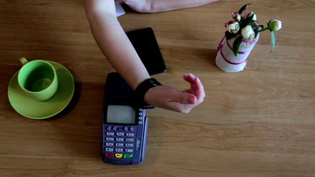 Girl was paying using a smart watch in a cafe video
