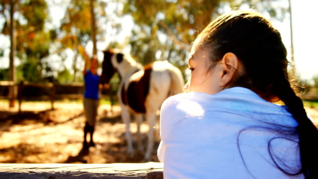 girl waving hand to her mother in ranch 4k - ranch video stock e b–roll