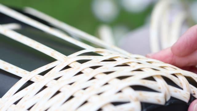 Girl wicker rattan basket sitting outdoors