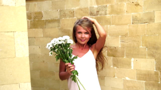 Girl with a bouquet of daisies video