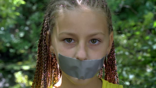 A girl with a taped mouth video