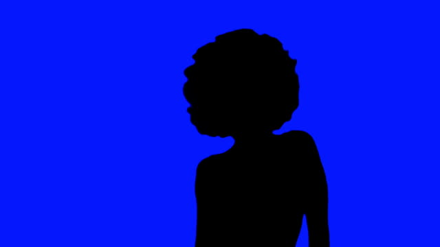 Girl with afro dances in Silhouette against blue video