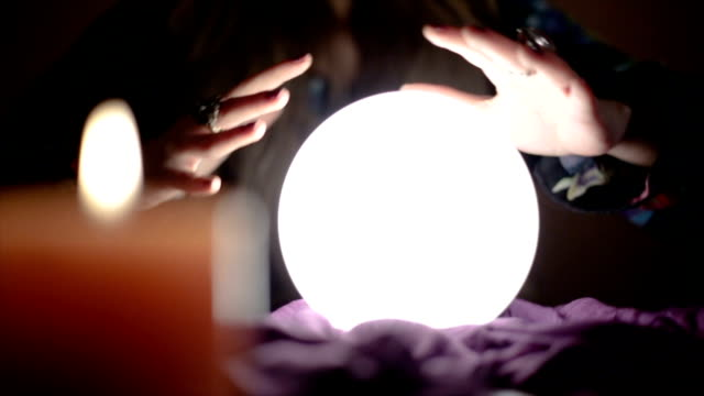Girl with crystal magic ball Young attractive girl with magic crystal ball prophesies fate paranormal stock videos & royalty-free footage