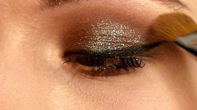 Girl with Makeup Brush. close up. Slow motion Beauty Girl with Makeup Brush. Bright Holiday Make-up for Woman. Beautiful Face. Makeover. Perfect Skin. Applying Makeup. close up. Slow motion eyeshadow stock videos & royalty-free footage