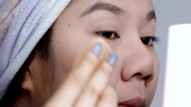 Girl with Makeup Brush. close up.