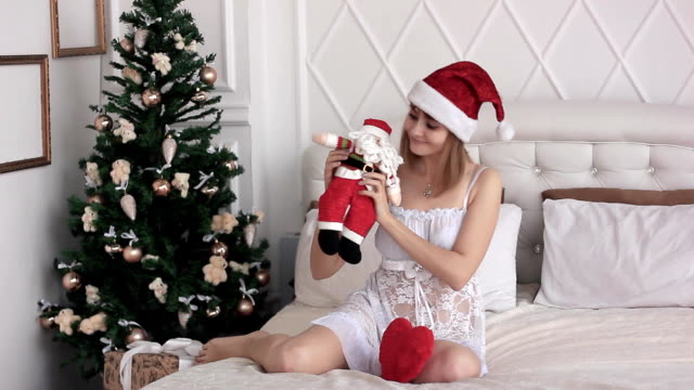 girl with Santa doll video