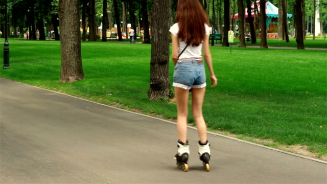 girl with slender legs in shorts riding on rollers young girl with slender legs in shorts riding on rollers charming stock videos & royalty-free footage