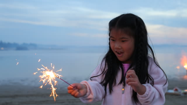 Girl with sparkler on Fourth of July Girl with sparkler on Fourth of July family 4th of july stock videos & royalty-free footage