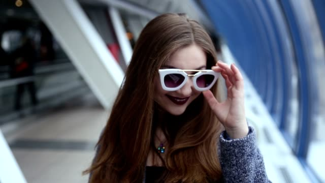 Girl with sunglasses playing and flirting video