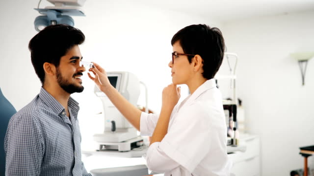 Girl woman in ophthalmology clinic for diopter detection video