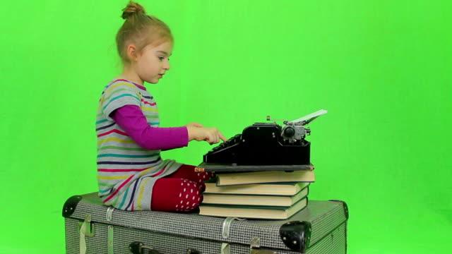 Girl writes for retro typewriter video