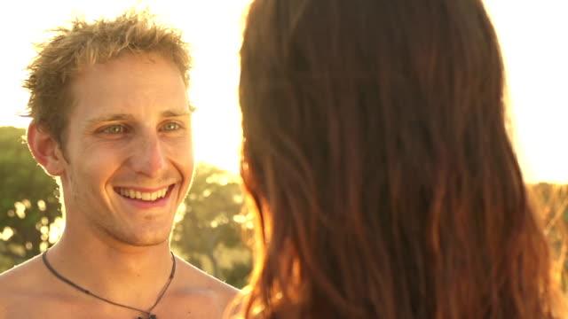 slow motion: girlfriend and boyfriend hugging at beautiful sunset - djurarm bildbanksvideor och videomaterial från bakom kulisserna