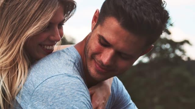 Girlfriend embracing boyfriend during vacation