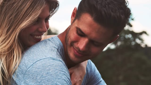 Girlfriend embracing boyfriend during vacation Handheld shot of young woman embracing boyfriend. Couple is enjoying during vacation. They are spending leisure time together. handsome people stock videos & royalty-free footage