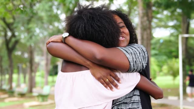 Girlfriends Embracing Friendship hug stock videos & royalty-free footage