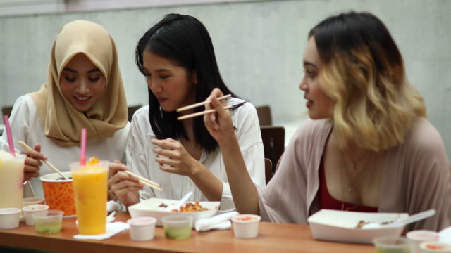 girlfriends on traditional malaysian lunch - chinese food stock videos and b-roll footage
