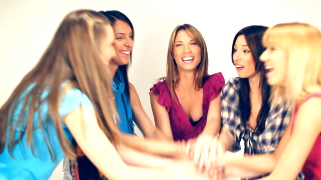 Girlfriends stacking hands together video