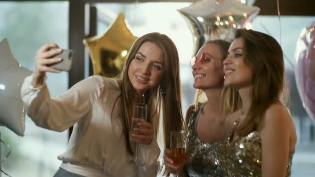 girlfriends with champagne making memories - bachelorette party stock videos and b-roll footage