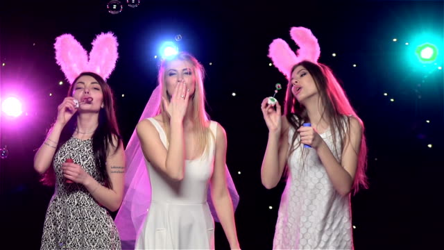 girls at bachelorette party blowing kisses, soap bubbles. slow motion - bachelorette party stock videos and b-roll footage