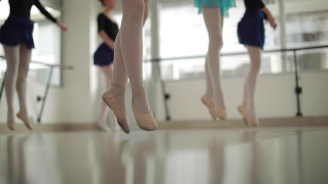 Girls ballet dancers practicing in studio Group of teenage girl practicing together in ballet studio. ballet dancer stock videos & royalty-free footage