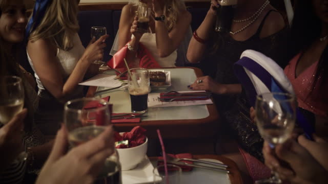 Girls drinking at a restaurant video