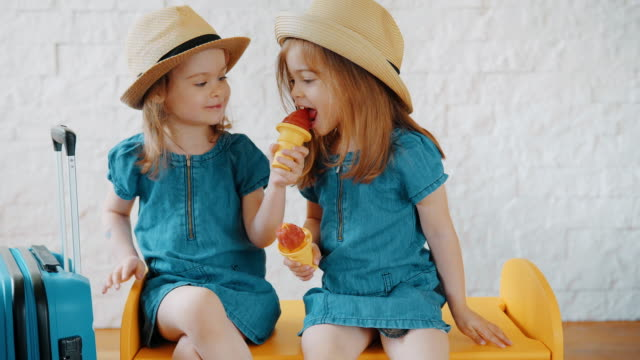 girls eat ice cream at home while waiting for a summer