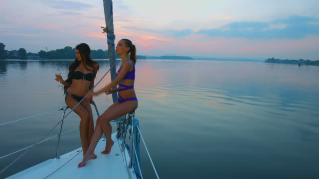Girls enjoy the beautiful view of the yacht. video