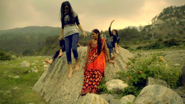 Girls enjoying vacation with mother in mountains. video