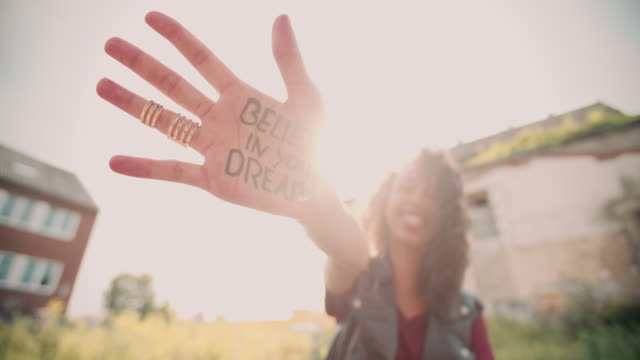 Girl's hand with 'Believe in your Dreams' written on it video