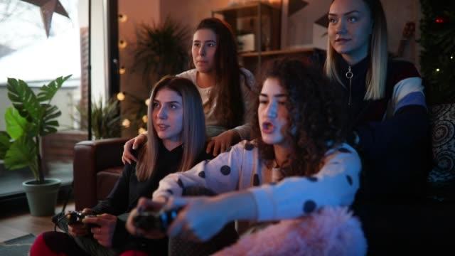 Girls having fun playing video games