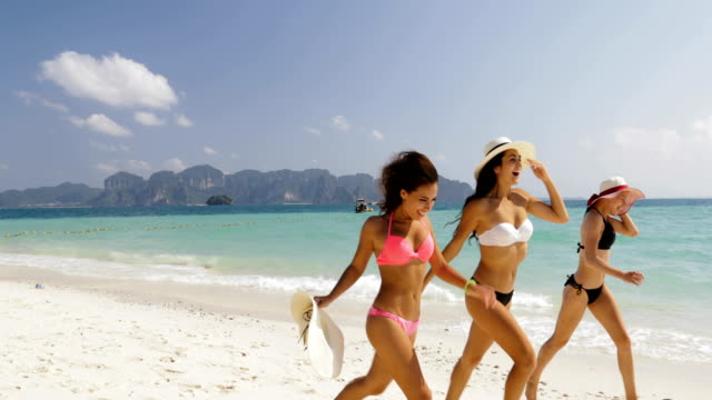 Girls In Bikini Running On Beach, Cheerful Women Group Tourists On Summer Holiday Girls In Bikini Running On Beach, Cheerful Women Group Tourists On Summer Holiday Slow Motion 60 bikini stock videos & royalty-free footage